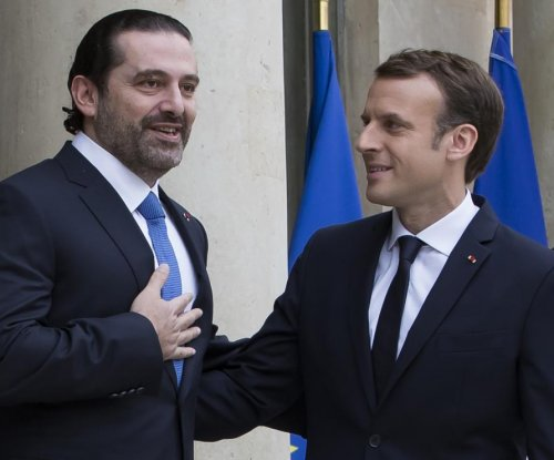 Embattled Lebanese prime minister meets with French president in Paris