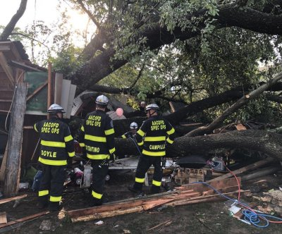 19 people hospitalized after tree falls on Maryland garage