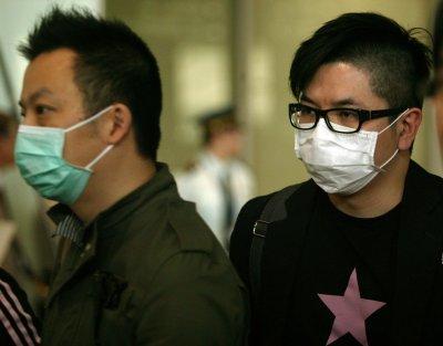 Swine flu death toll in Britain reaches 14