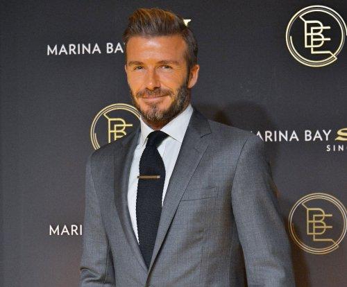 David Beckham gives daughter Harper first soccer lesson