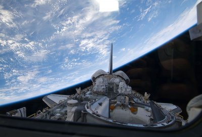 STS-129's first spacewalk is completed