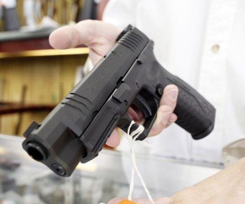 Delta baggage handler charged with aiding gun smuggler