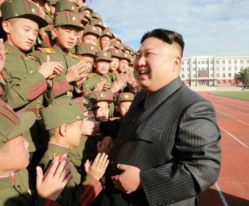 Kim Jong Un visits school, stays away from provocations