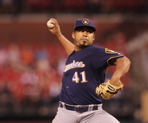 Brewers play through injuries, focus on Reds
