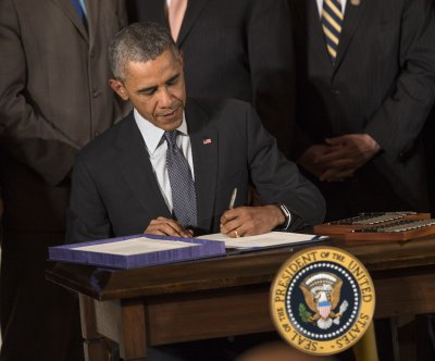 Obama signs fast-track trade, worker assistance bills into law