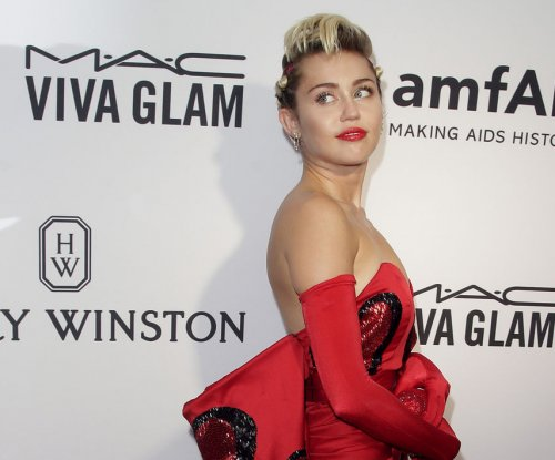 Miley Cyrus finds 'balance' between yoga, antics on weekend Instagram spree
