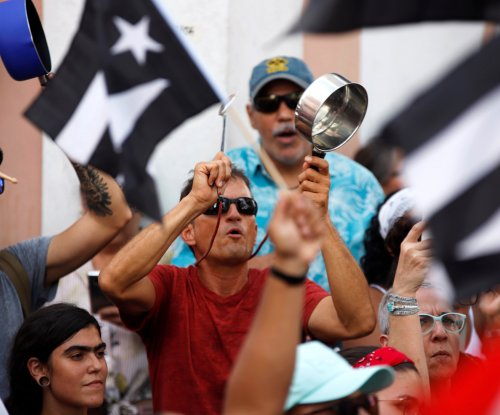Puerto Ricans return to streets as Democratic hopefuls call for Rosselló's resignation