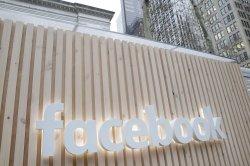Justice Department accuses Facebook of favoring visa workers
