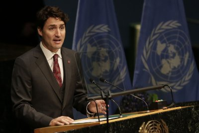 Canadian PM Trudeau apologizes after 'manhandling lawmakers