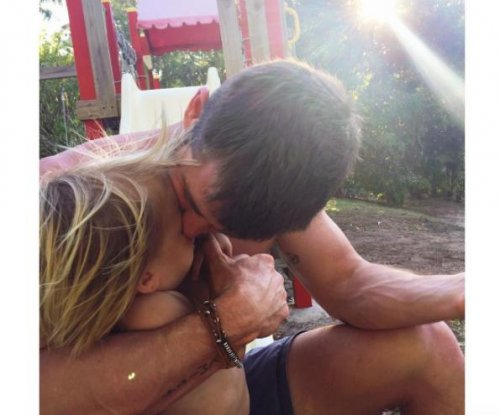 Chris Hemsworth cuddles toddler son in new photo