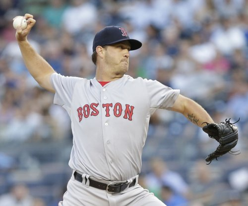 Boston Red Sox get Patriots Day victory behind Steven Wright