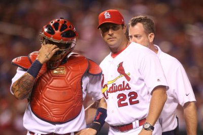 Cardinals, Holland take aim at Brewers