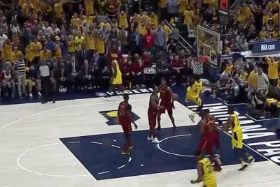 Pacers' Victor Oladipo dunks on top of Cavaliers' LeBron James