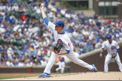 Cubs take a swing at sweeping Reds