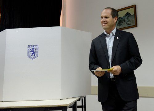 Incumbents claim mayoral victories in Jerusalem, Tel Aviv