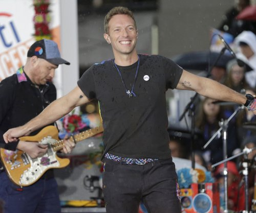 Chris Martin pays tribute to George Michael during homeless shelter performance