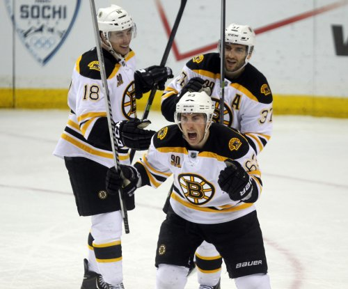 Brad Marchand leads Boston Bruins over Pittsburgh Penguins