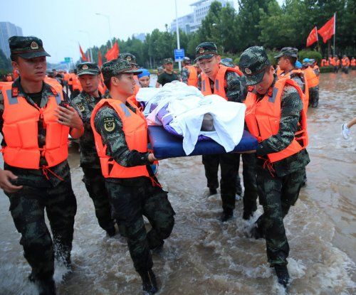 Woman in China dies after throwing baby to safety during deadly flood