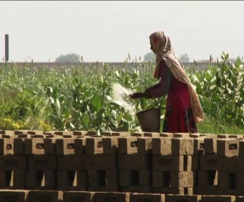 Pakistani activists want kilns to pay working women, not their husbands