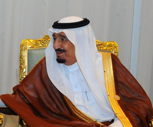 Saudi king fires senior aide after video shows him slap photojournalist