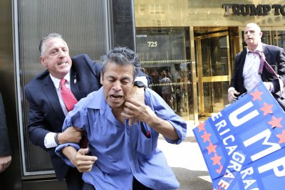 Demonstrators sue Trump after sidewalk scuffle with security team