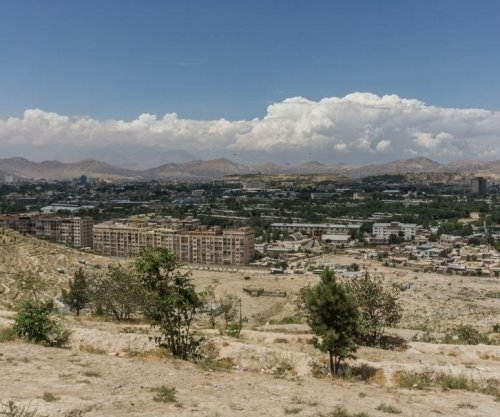 Truck bomb leads Taliban attack on a hotel compound in Kabul