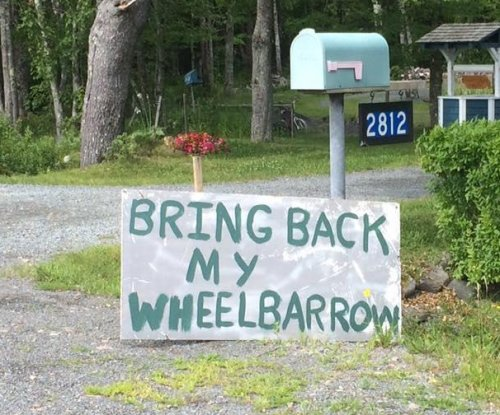 Signs relate saga of missing and returned wheelbarrow