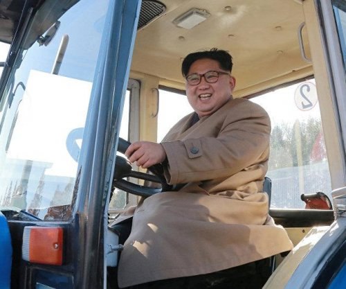North Korea displays new trucks in defiance of sanctions