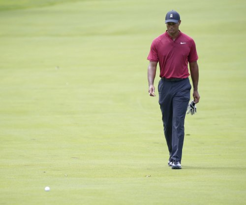 BMW Championship: Tiger Woods ties course record with opening round 62