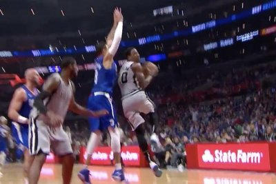 DeMar DeRozan delivers smooth 360 lay-up in traffic