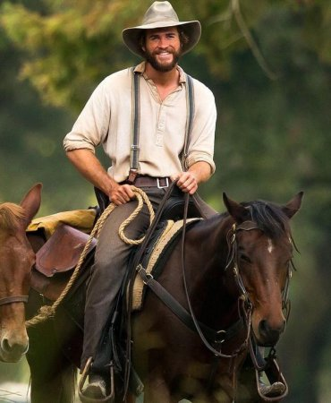 Liam Hemsworth cowboys up on set of 'By Way of Helena'