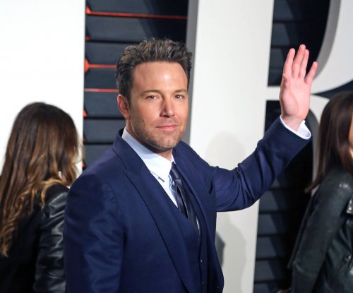 Ben Affleck says that phoenix tattoo on his back is fake