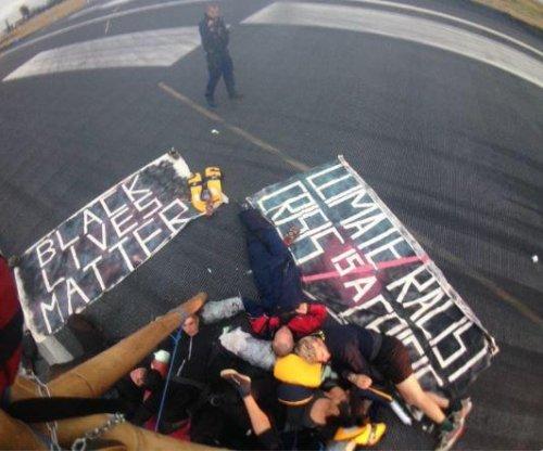 Black Lives Matter protesters close London runway