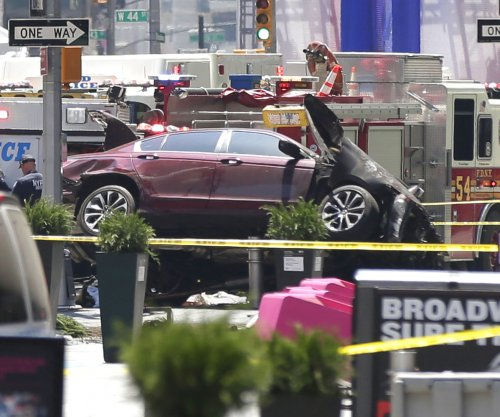 One dead, 12 injured after car hits pedestrians in Times Square