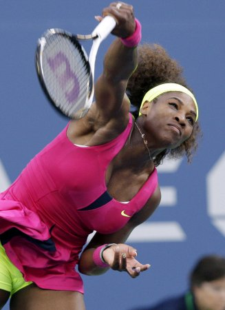 Williams, behind serve, extends Madrid winning streak