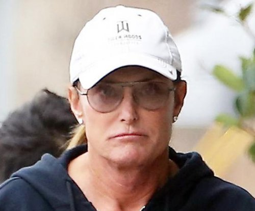Bruce Jenner rocks ponytail, French manicure and diamond earrings