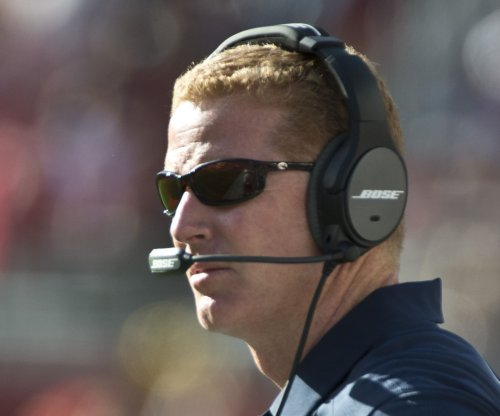 Dallas Cowboys' Jason Garrett talks with Greg Hardy about comments