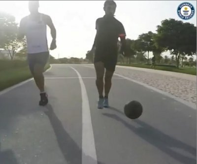 Athlete breaks Guinness record for fastest mile while dribbling