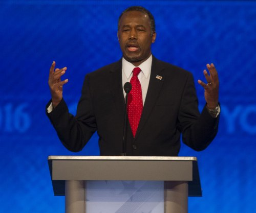 Carson gets first congressional endorsement, vows to stay in race