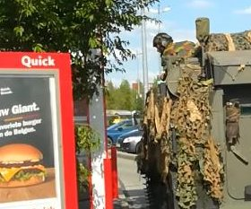 Military tank uses fast food drive through in Belgium