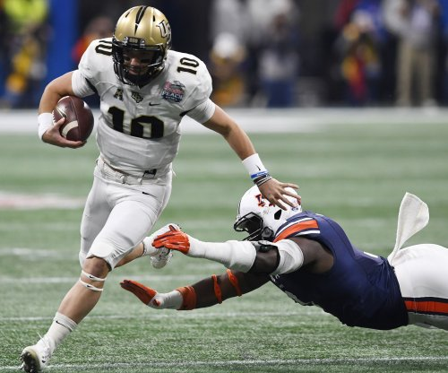 Peach Bowl: Scott Frost, UCF Knights complete perfect season by beating Auburn Tigers
