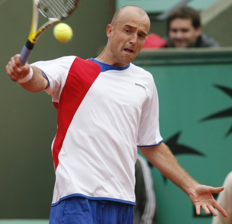 Ljubicic opens tournament defense with win