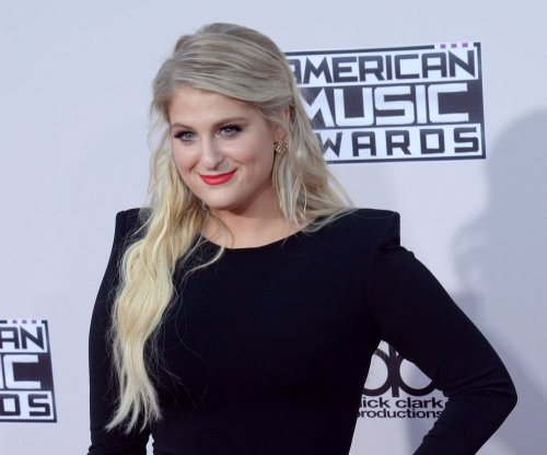 Meghan Trainor kiss was 'weird,' says Charlie Puth