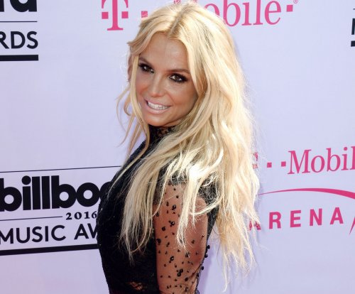 Britney Spears opens Billboard Music Awards show in sparkly red bikini and boots