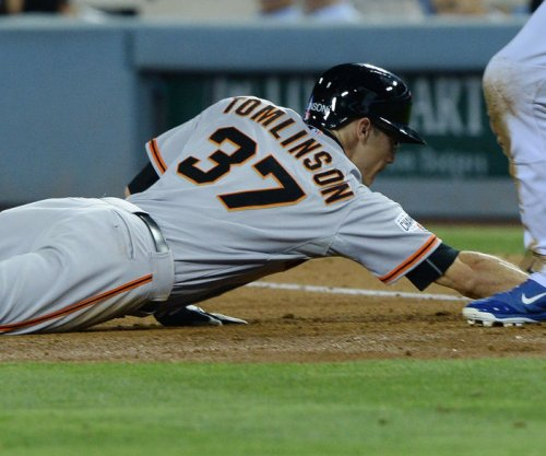 MLB: Nick Hundley's 12th-inning RBI sends San Francisco Giants past San Diego Padres