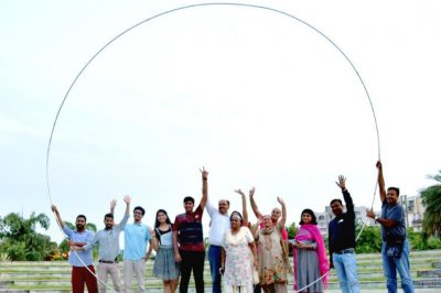Indian father and son spin giant hula hoop for Guinness record