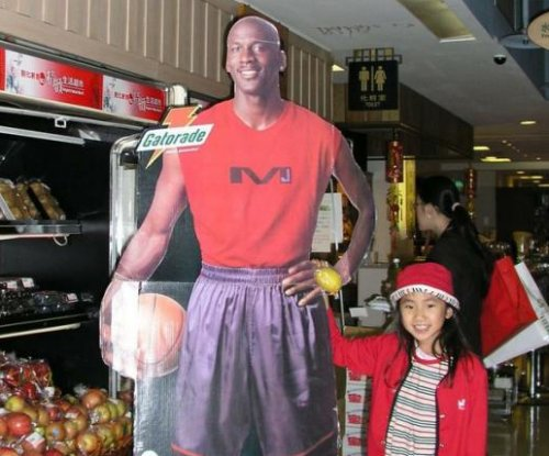 Woman's hilarious childhood love of cardboard Michael Jordan goes viral