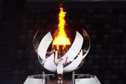 Tennis star Naomi Osaka lights cauldron to kick off Olympics