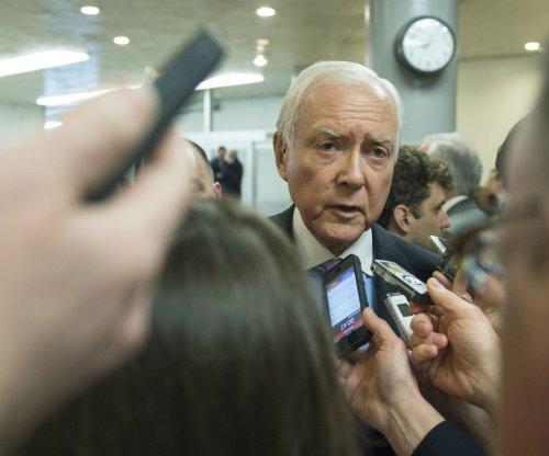 Senate OKs Obama's fast-track trade bill, House battle expected