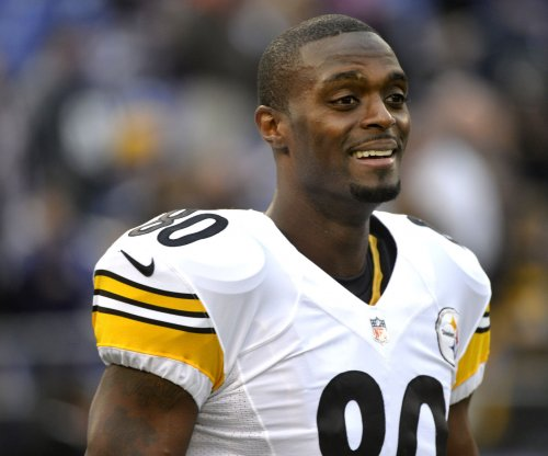 Plaxico Burress receives probation for tax evasion